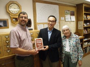 Dae Wee Kim holds the Greek-English New Testament that returned from South Korea to Harleysville last year.
