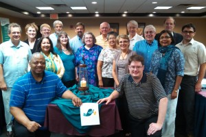 All members of the Executive Board, with their prayer lamp centerpiece for the weekend, as well as Stella, the official Mennonite Church USA convention dove.