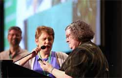 Elizabeth Soto Albrecht prays with Patricia Shelly, newly installed moderator. (Photo courtesy of: MCUSA)