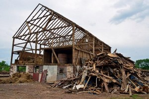 Hartland Demolition & Restoration is in the midst of dismantling a barn in Hilltown for the Nyce Barn Project. News-Herald photo — DEBBY HIGH