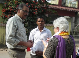 Pastor Ravi Baksh and Karen Moyer talk with a young man who purchased two New Testaments--one for himself and one for his brother.