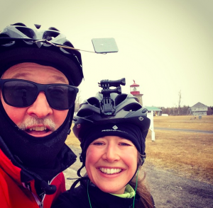 Sarah French and her father take a break during a training ride.